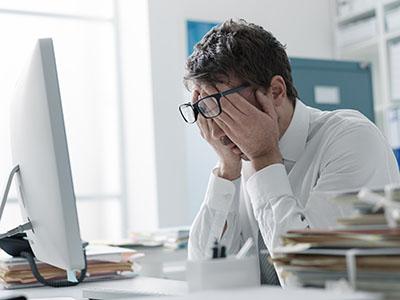 Tired stressed businessman